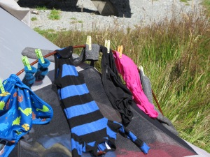 Joey's diaper covers and wool clothing drying on our tent during an overnight hiking trip