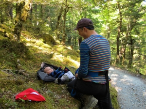 Diaper change and play time in the NZ bush along the Routeburn Track