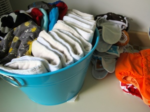 ALL of our cloth diapers. From left - best bottom covers, hybrid inserts, night-time diapers, easy-to-use pockets for babysitters and after-swim