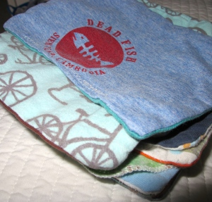 Handmade cloth wipes from super-soft old t-shirts & sheets, plus some fun flannel from the fabric store.