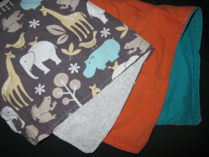 T-shirts transformed into handmade burp cloths - same method as the wipes, bigger pieces of fabric!