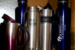 our stash of reusable coffee cups and water bottles.