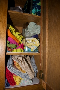 Our stash of fabric (reusable) linens for the kitchen- from the bottom up are dish towels, napkins, dish cloths, baby wash cloths, and snack bags.