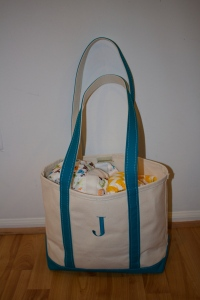 """Joey's day care bag is stocked with everything a baby needs - change of clothes, blanket, and lots of diapers, all meticulously labeled """"Joey F."""" on the tags."""