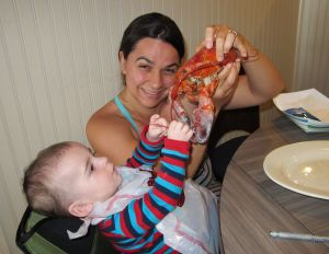 Flying lets babies participate in adventures and experiences they may not otherwise have - like having a real lobster in Boston!