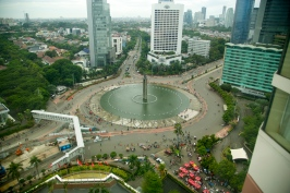 Car-free day in Jakarta, seen from our room at the Hyatt. Vendor carts with red roofs are on the lower right.