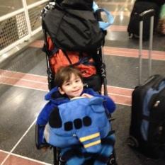 Joey loves his airplane bag.