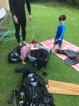The boys are getting very good at their job - clean dive/snorkel gear with hose